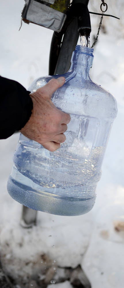 Filling a jug with ater